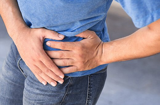 man in pain with prostatitis