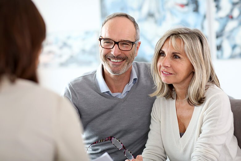 happy older couple speaking to erectile dysfunction specialist