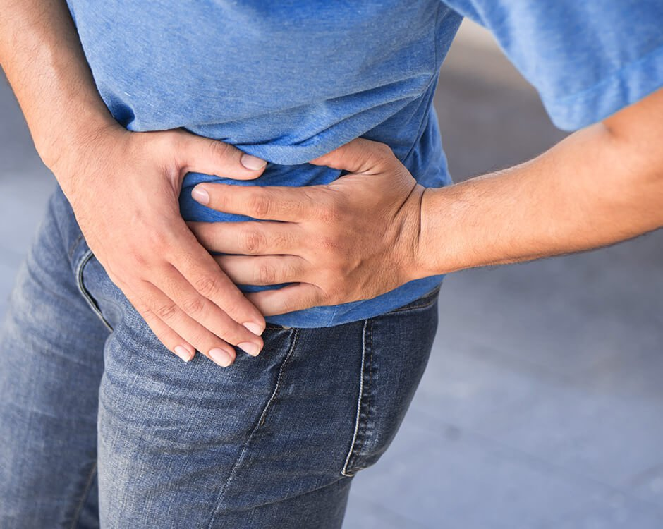 man in pain from prostatitis